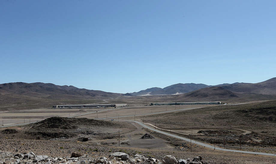 "The buildings housing, Diapers.com, left, and Zulily.com and Toys ""R"" Us are dwarfed by the immensity of the Tahoe-Reno Industrial Center, nine-miles east of Reno off IH-80, Wednesday, May 14, 2014.Nevada is in competition with Texas along with three other states for a $5 billion Tesla Gigafactory. It will produce lithium batteries for its vehicles. Tesla is expected to announce and break ground at a site in early June. The factory is expected to employ 6,000. Photo: Jerry Lara, San Antonio Express-News / ©2014 San Antonio Express-News"