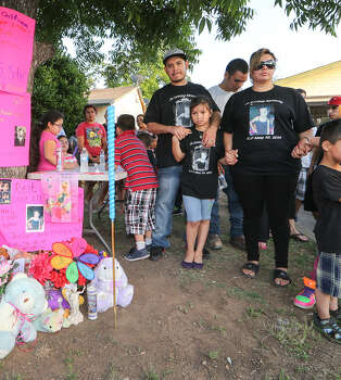 Mother Jennifer DonJuan, sister Jenabell Montana, 8, and father Johnny Montana stand with family, neighbors and friends during a candlelight vigil for Jennilynn Montana. Photo: Marvin Pfeiffer / San Antonio Express-News / Express-News 2014