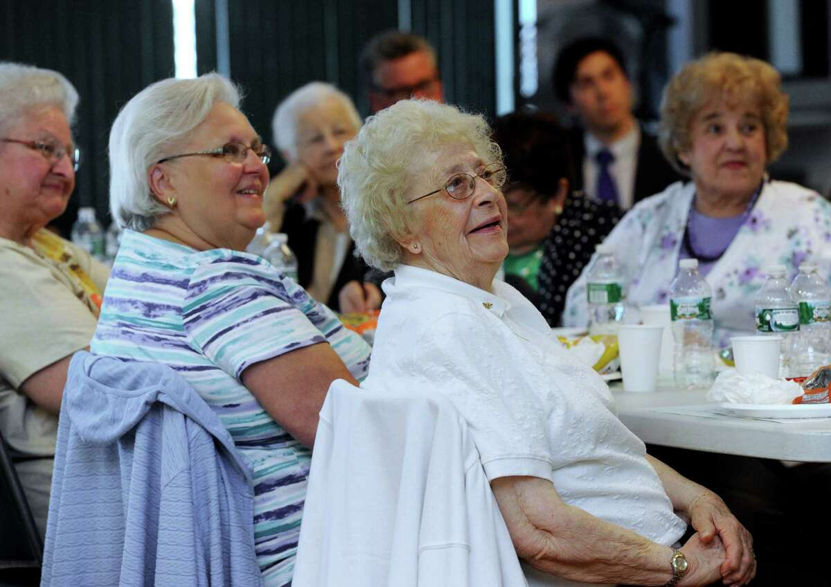 """From second from left, JoAnn Farrell, Elsie Palmieri and Hilda Nichols listen to speakers at Danbury's Aging in Place Planning Council meeting Tuesday at Elmwood Hall, the Danbury senior center. The group met to discuss the impact of the """"Silver Tsunami"""" for state and local communities, May 20, 2014."""