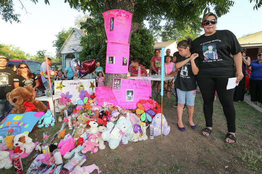 Jennifer DonJuan (right), stands with her eight-year-old daughter Jenabell Montana beside a makeshift memorial during a candellight vigil for her other daughter, six-year-old Jennilynn Montana, at 1444 Aransas on Tuesday, May 20, 2014.  Jennilynn was a victiim of an accidental shooting at the residence the previous Sunday.   MARVIN PFEIFFER/ mpfeiffer@express-news.net Photo: MARVIN PFEIFFER, Marvin Pfeiffer/ EN Communities / Express-News 2014
