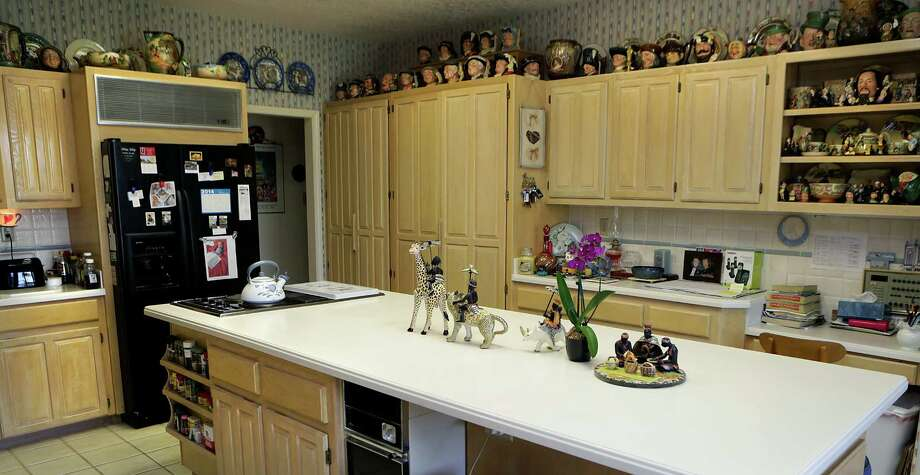 The pottery collection in the home of Ann and George Berg fills practically every space in the kitchen. Photo: BOB OWEN, San Antonio Express-News / © 2012 San Antonio Express-News