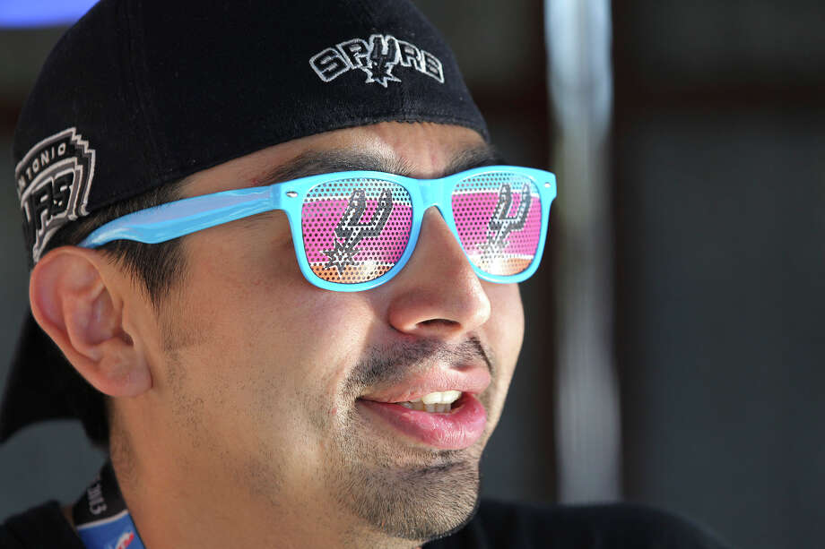 Hector Escobedo sports retro glasses as Spurs fans start to party before the opener against the Thunder at the AT&T Center on May 19, 2014. Photo: TOM REEL