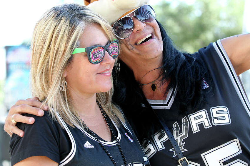 Loriann Williams and Ronnie Morin pose for a photo as Spurs fans start to party before the opener against the Thunder at the AT&T Center on May 19, 2014.