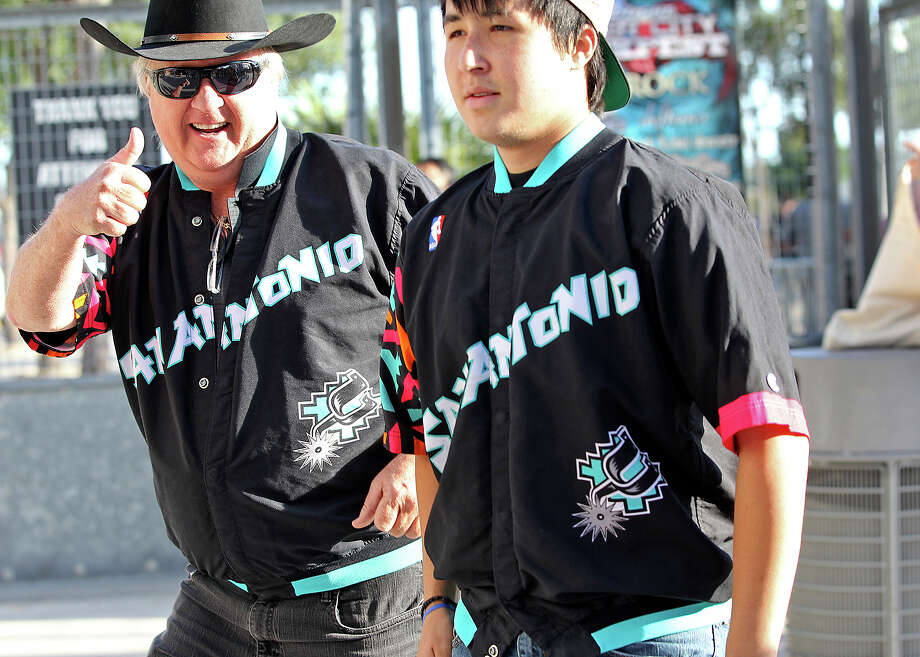 Joe Calvey (left) with his son Joey Calvey show up with authentic warmup jerseys from Sean Elliott and Avery Johnson as Spurs fans start to party before the opener against the Thunder at the AT&T Center on May 19, 2014. Photo: TOM REEL