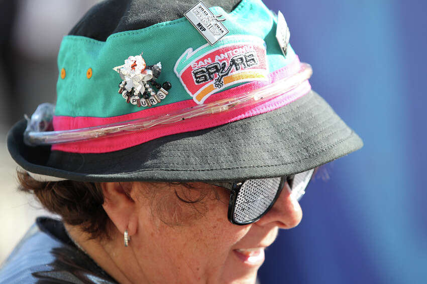 Martha Urias shows off retro colors and logo on her hat as Spurs fans start to party before the opener against the Thunder at the AT&T Center on May 19, 2014.