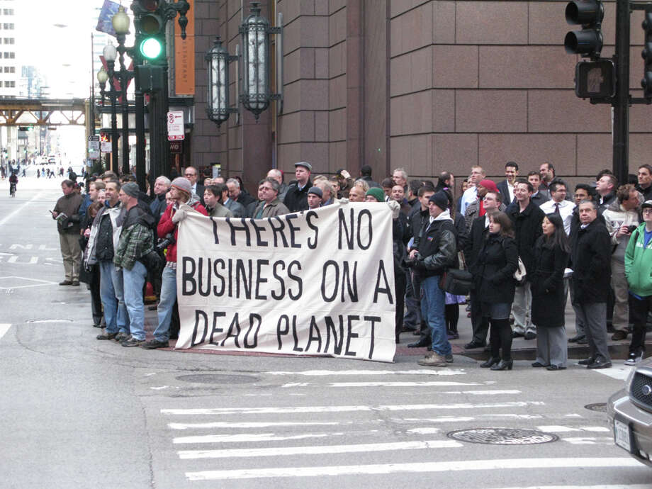 cap-and-trade (adj.,1995): relating to or being a system that caps the amount of carbon emissions a given company may produce but allows it to buy rights to produce additional emissions from a company that does not use the equivalent amount of its own allowance  PHOTO: Chicago Climate Justice activists protest cap-and-trade legislation in Chicago on Nov. 30, 2009. Photo: Wesha, Wikimedia Commons