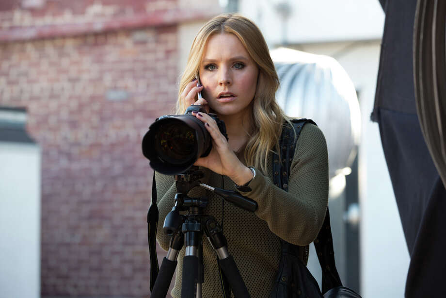 """crowdfunding (n., 2006): the practice of soliciting financial contributions from a large number of people esp. from the online community (aka how the new """"Veronica Mars"""" movie was funded)  PHOTO: Kristen Bell in a scene from """"Veronica Mars."""" Photo: Robert Voets, Warner Bros. Pictures / Warner Bros. Pictures"""