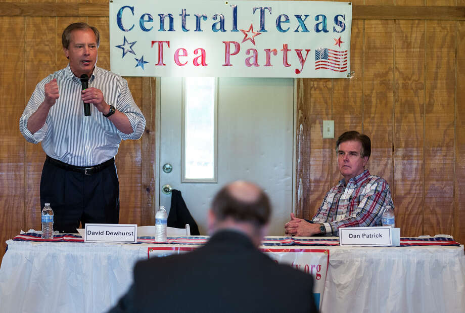 State Sen. Dan Patrick, right, sits near as Lt. Gov. David Dewhurst talks in Salado, Texas, on Tuesday, May 20, 2014. (AP Photo/Austin American-Statesman, Ricardo B. Brazziell) Photo: Ricardo B. Brazziell, Associated Press / Austin American-Statesman