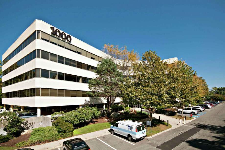 This 134,000-square-foot office building at 1000 Bridgeport Ave., in Shelton has been purchased  by Fairfield Realty Group for $8.1 million. The building is 62 percent occupied. Photo: Contributed Photo / Connecticut Post Contributed