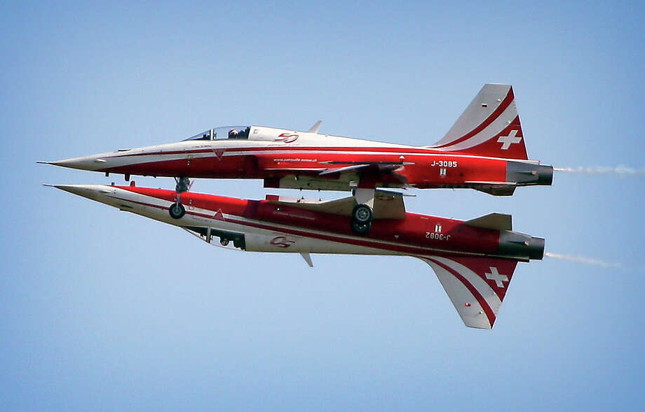 Two Northrop F-5E Tiger II airplanes of the Swiss Patrol fly close together during an aerobatic performance   at the ILA Berlin Air Show in Berlin, Germany, Tuesday, May 20, 2014. The Berlin Air Show takes place from May 20 until May 25, 2014 . Photo: Michael Sohn, ASSOCIATED PRESS / AP2014
