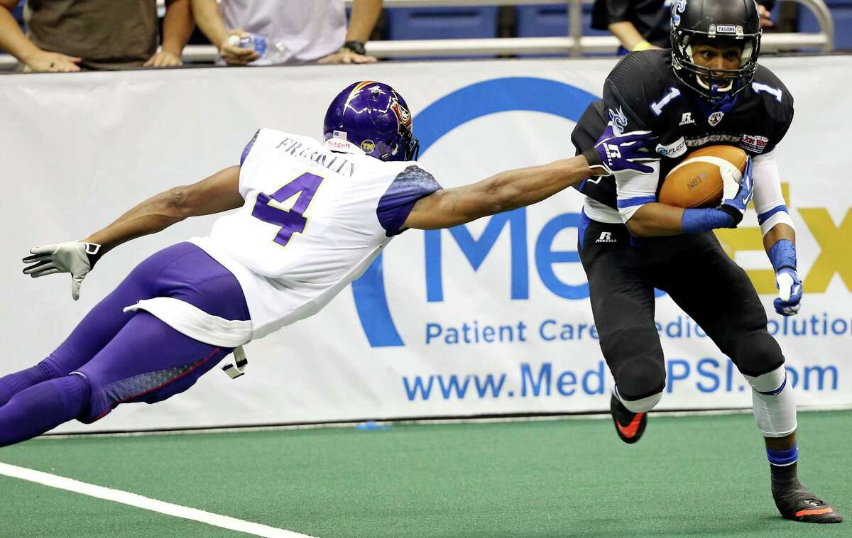 San Antonio Talons' Kelvin Rodgers looks for room around New Orleans VooDoo's Carlese Franklin during second half action Saturday May 17, 2014 at the Alamodome. The VooDoo won 62-44.