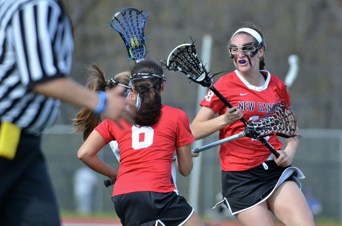 New Canaan's Samantha Stewart (18) stands on the field during the girls lacrosse game against Darien at Darien High School on Friday, May 2.
