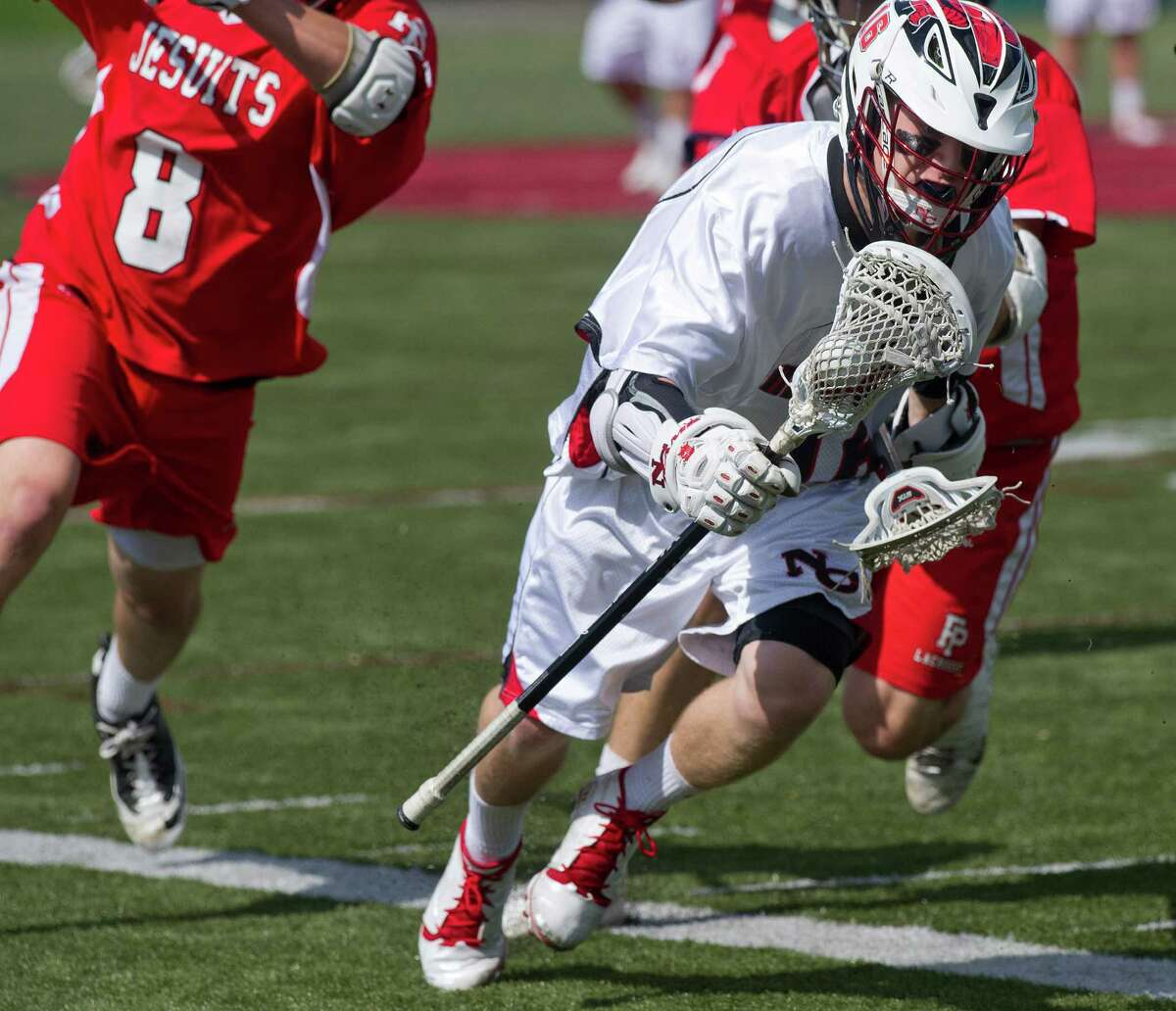 New Canaan's Harry Stanton controls the ball during Saturday's lacrosse game against Fairfield Prep on May 17.
