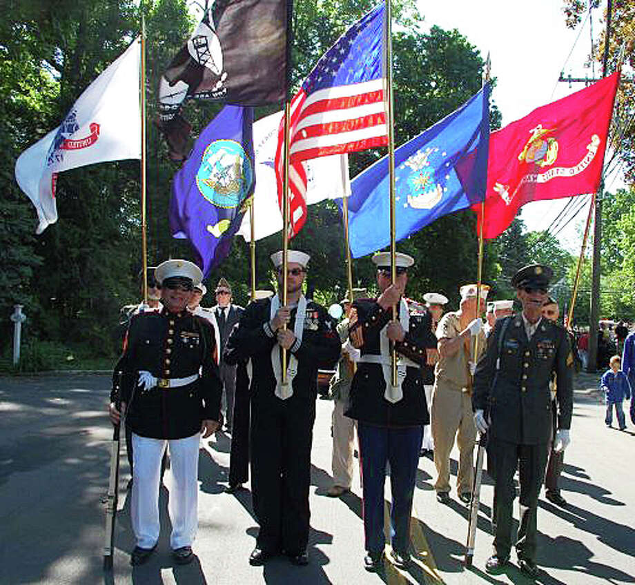 Representatives from branches of the nation's armed services form the honor guard for last year's Memorial Day parade in Westport. Photo: File Photo / Westport News