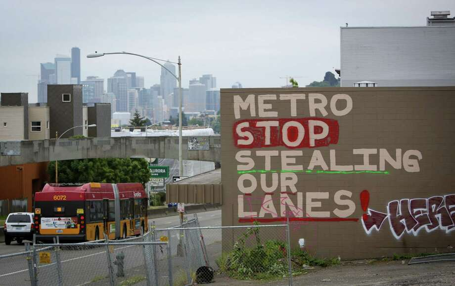 Graffiti complaining about lanes on the roadway being dedicated to buses, taking up travel lanes from cars and the loss of parking spaces on Aurora Avenue North in Seattle on Wednesday, May 2, 2014. Photo: JOSHUA TRUJILLO, SEATTLEPI.COM / SEATTLEPI.COM