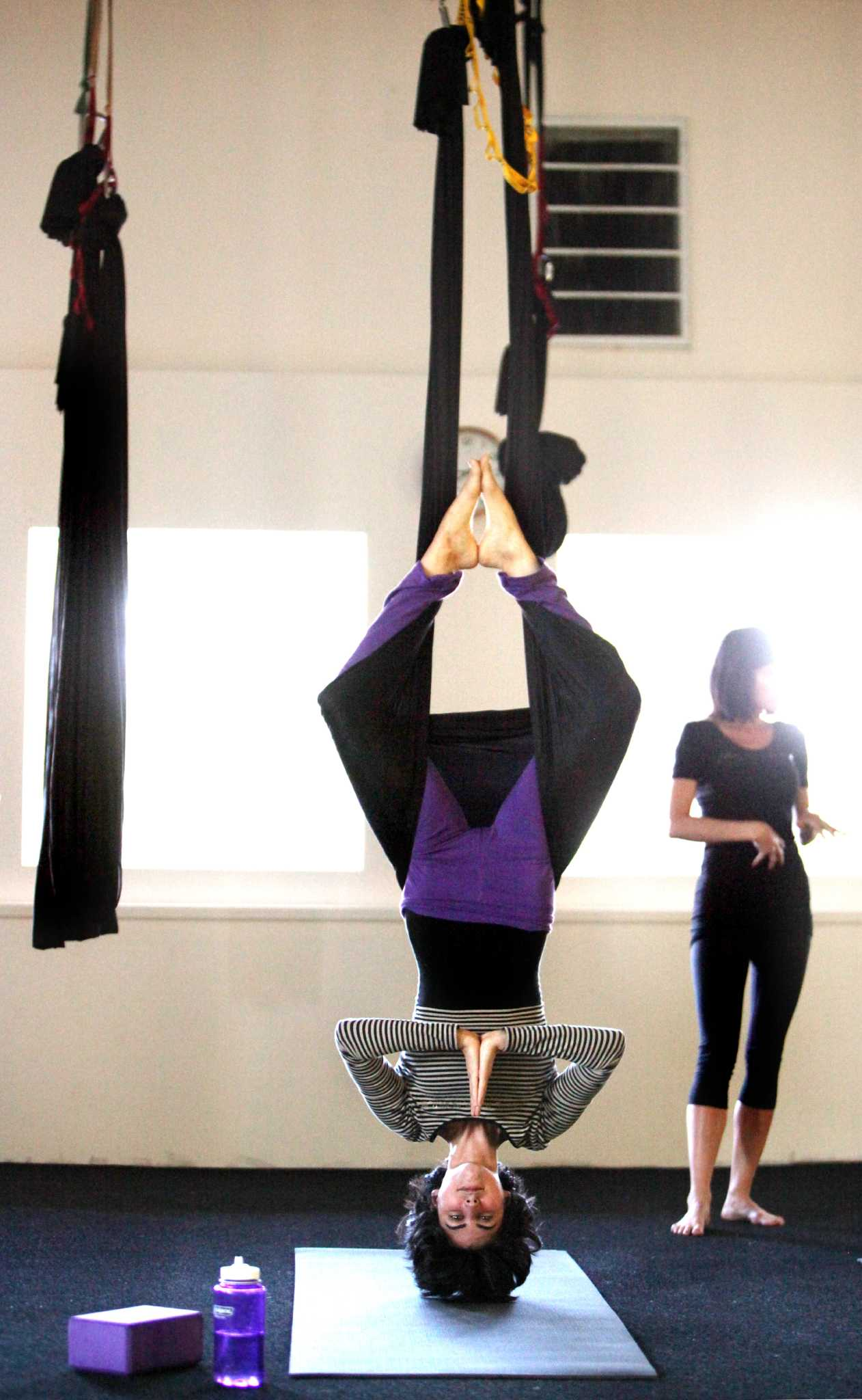Bmw Of Houston >> Aerial Yoga Houston helps you fly high, stretch long - Houston Chronicle
