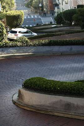 """Cars makes their way down the """"crooked section"""" of Lombard Street in San Francisco, CA, Friday, January 3, 2014."""