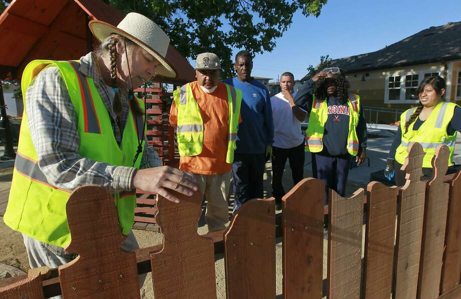 Toody Maher (left) advises a team of paid staff rebuilding Pogo Park in Richmond, Calif. on Tuesday, May 6, 2014, in preparation for the park's grand opening in the fall. They are: Richard Muro, Daniela Guadalupe, Jose Juan Reyes, Eddie Doss, Karina Guadalupe and Tonie Lee. Photo: Paul Chinn, The Chronicle