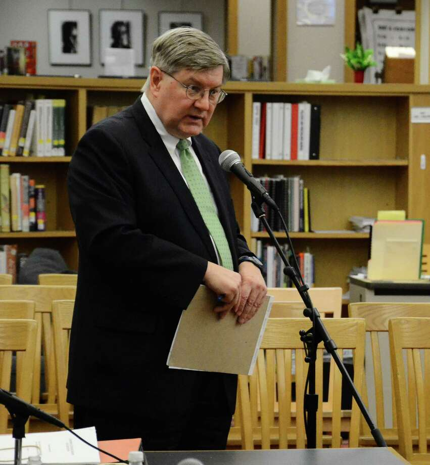 Thomas B. Mooney, a partner at Shipman & Goodwin and an attorney for the Board of Education, addresses the board at a special meeting Tuesday, May 20, 2014, at the New Canaan High School library in New Canaan, Conn. Photo: Nelson Oliveira / New Canaan News
