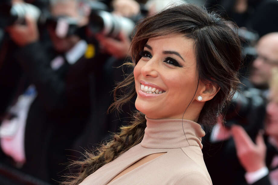 "Actress and director Eva Longoria poses as she arrives for the screening of the film ""Foxcatcher"" at the Cannes Film Festival in Cannes, southern France, on May 19, 2014. Photo: BERTRAND LANGLOIS, AFP/Getty Images / AFP"