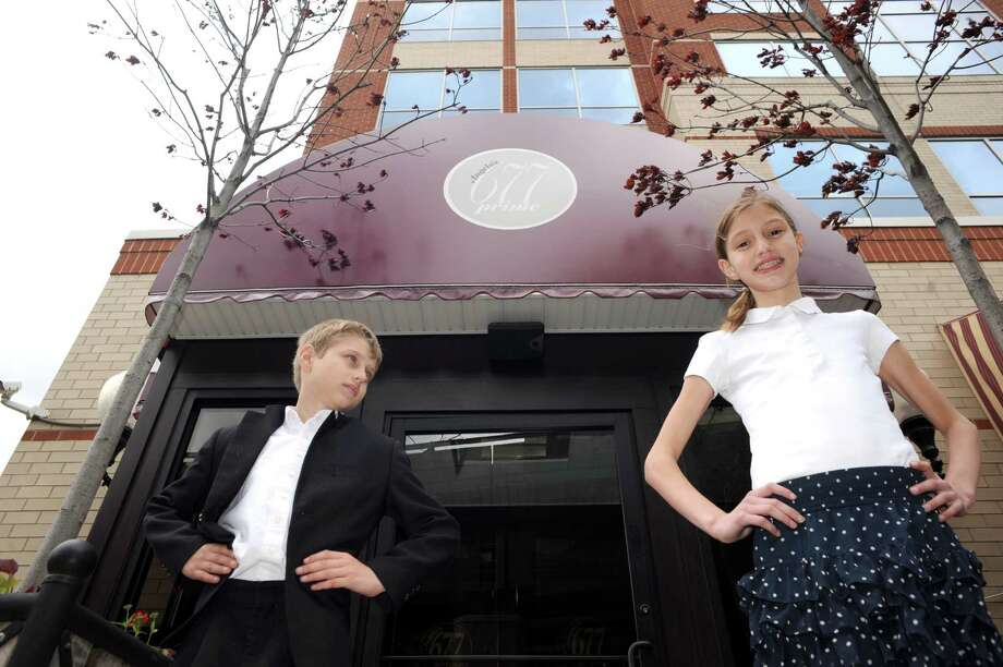 Eight-year-old Peter and 11-year-old Caroline Wajda stand in front of 677 Prime restaurant Friday May 16, 2014, in Albany, N.Y. (Michael P. Farrell/Times Union) Photo: Michael P. Farrell / 00026914A