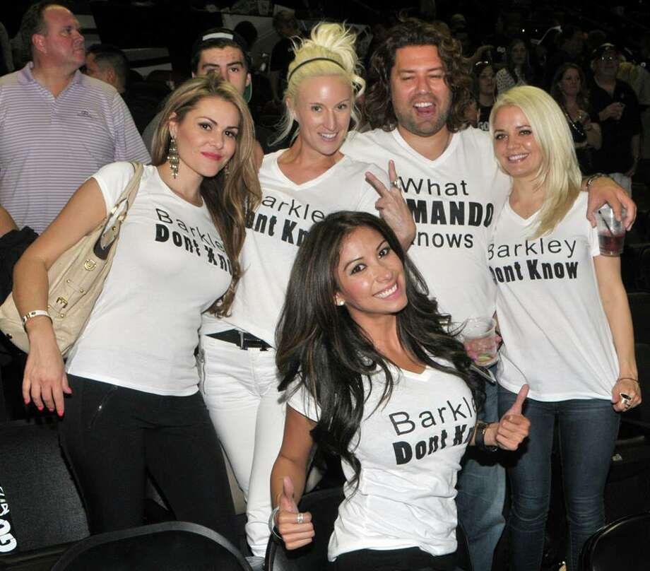The national press is buzzing about an effort led by Tim Duncan's girlfriend, Vanessa Macias, to teach Charles Barkley about the beauty of S.A. women. Macias — and a group of other female Spurs fans — showed up at Monday's game wearing T-shirts evidently commissioned by Macias' employer, S.A. real estate celebrity, Armando Montelongo. Photo: Toni Mcknight Adams,  Courtesy