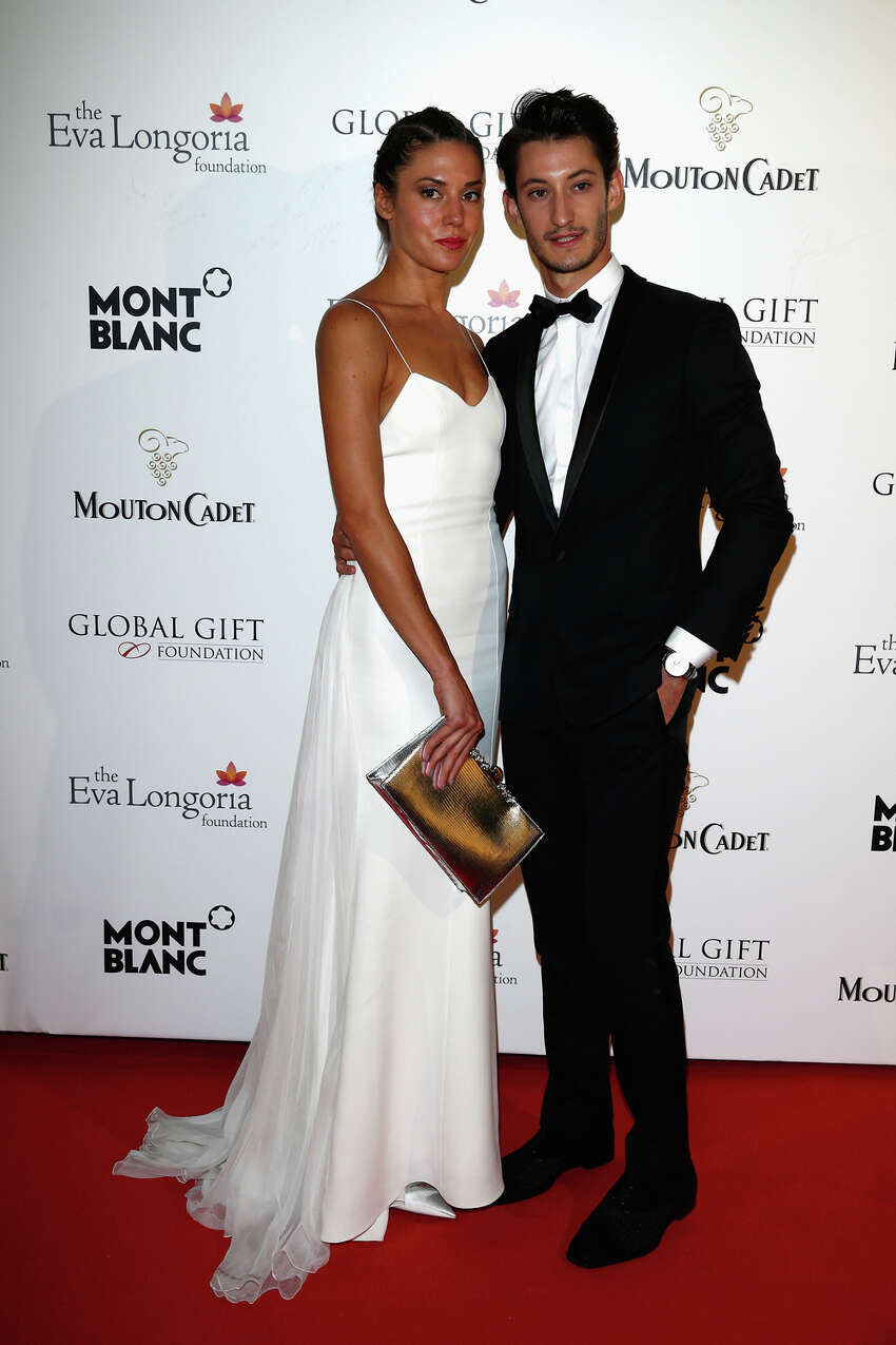 Pierre Niney (right) attends the Global Gift Gala hosted by Eva Longoria during the 67th Annual Cannes Film Festival on May 16, 2014 in Cannes, France.