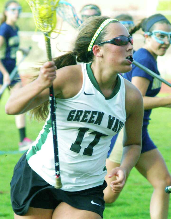 Green Wave standout Marisa McLaughlin searches for a seam in the Lancers' defense as she romps toward the net during New Milford High School girls' lacrosse's 16-5 victory over Notre Dame of Fairfield, May 14, 2014 at NMHS. Photo: Norm Cummings / The News-Times