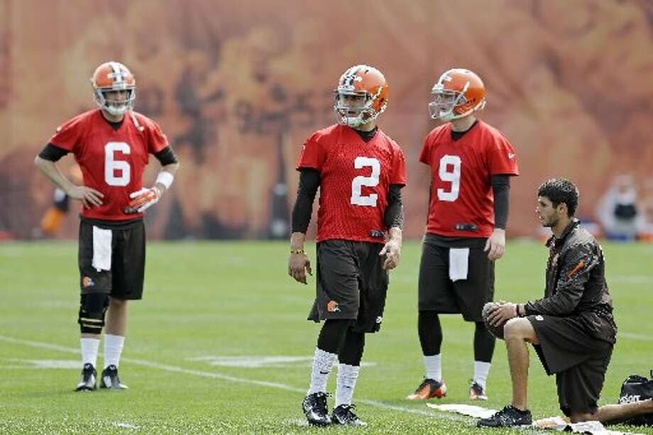 Browns QBs Johnny Manziel (2), Brian Hoyer (6) and Connor Shaw (9) wait to take part in a drill. Photo: Mark Duncan, Associated Press