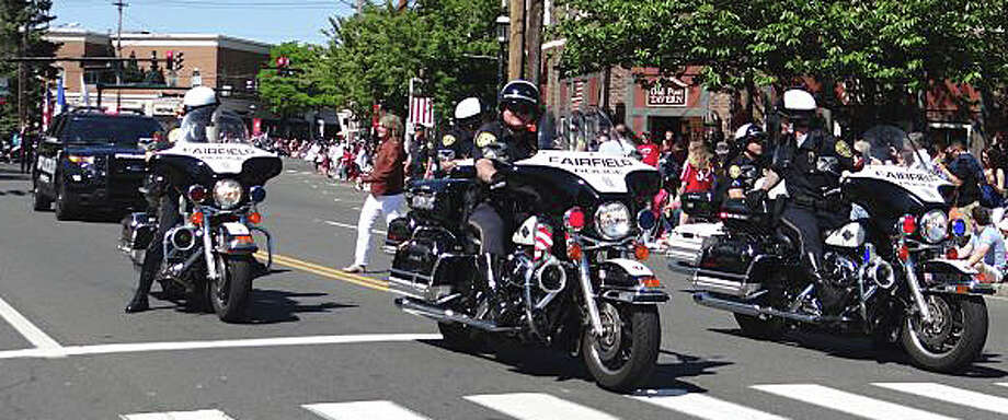 A police motorcycle detail leads the Memorial Day parade through downtown last year -- the same route that marchers will follow Monday for this year's parade. Photo: File Photo / Fairfield Citizen
