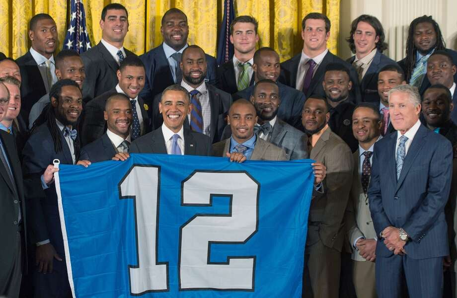 President Barack Obama poses with the Super Bowl-champion Seattle Seahawks during an event at the White House in Washington, DC on May 21, 2014. Photo: Jim Watson, AFP/Getty Images