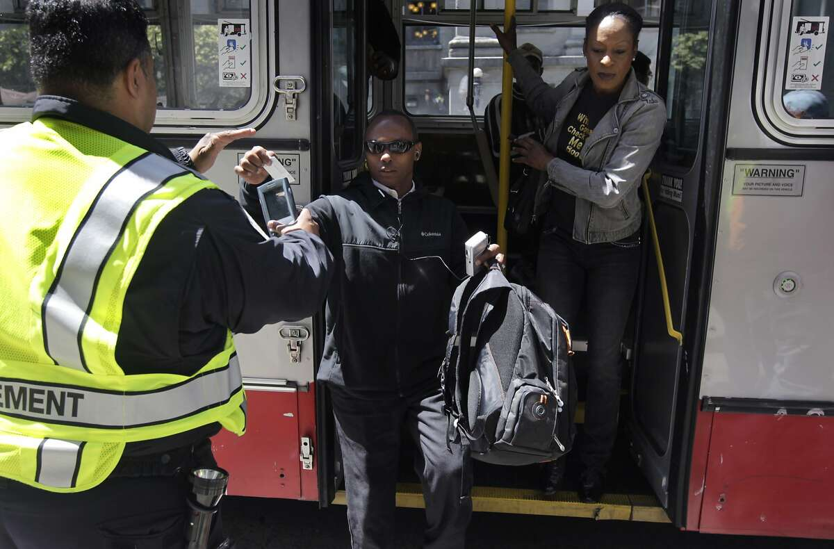 Muni transit fare inspector J. Colon (left) checks for fare evaders exiting a 14-Mission bus at Fifth and Mission streets in San Francisco, Calif. on Tuesday, May 20, 2014. Many of the Clipper card fare readers aboard the buses are inoperable so some riders think they can ride for free.