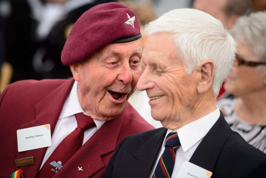 Remember the time ... World War II veterans Geoffrey Pattison (left) and Ronald Knight share war stories aboard the HMS Belfast in London during an event marking the 70th anniversary of D-Day. HMS Belfast was one of the first ships to open fire on German positions at 5:27 A.M.  June 6, 1944, and is one of only three remaining vessels of the bombardment. Photo: Leon Neal, AFP/Getty Images
