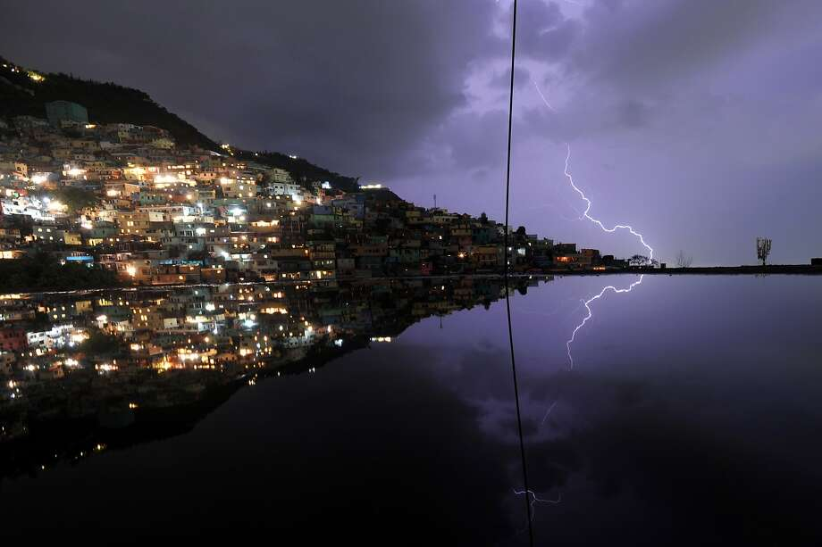 Lightning strikesduring an evening thunderstorm in the Haitian capital Port-au-Prince. Photo: Hector Retamal, AFP/Getty Images