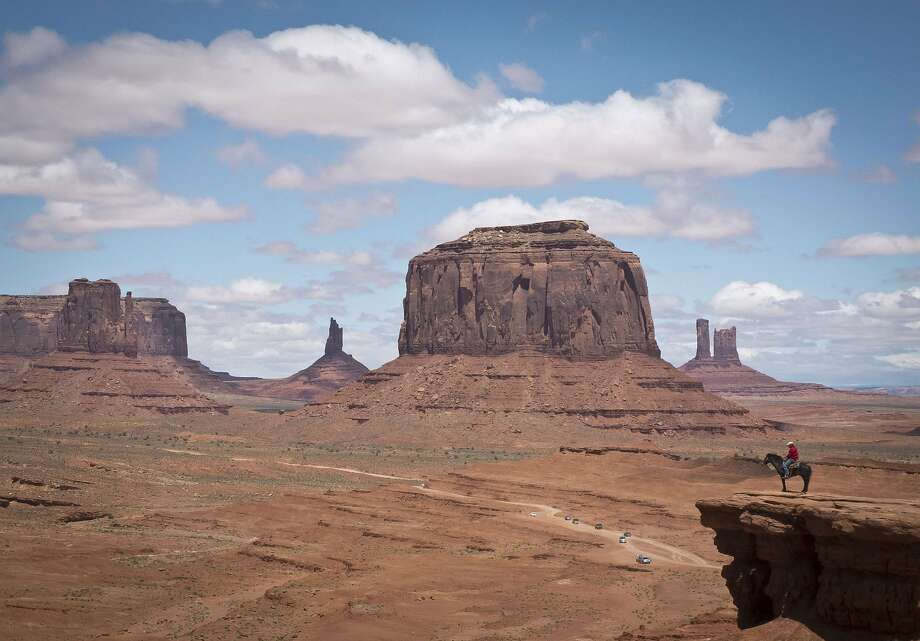 Please don't spook the horse:A mounted Navajo poses for tourists in front of Merrick Butte in Monument Valley Navajo Tribal Park, Utah. Photo: Mladen Antonov, AFP/Getty Images