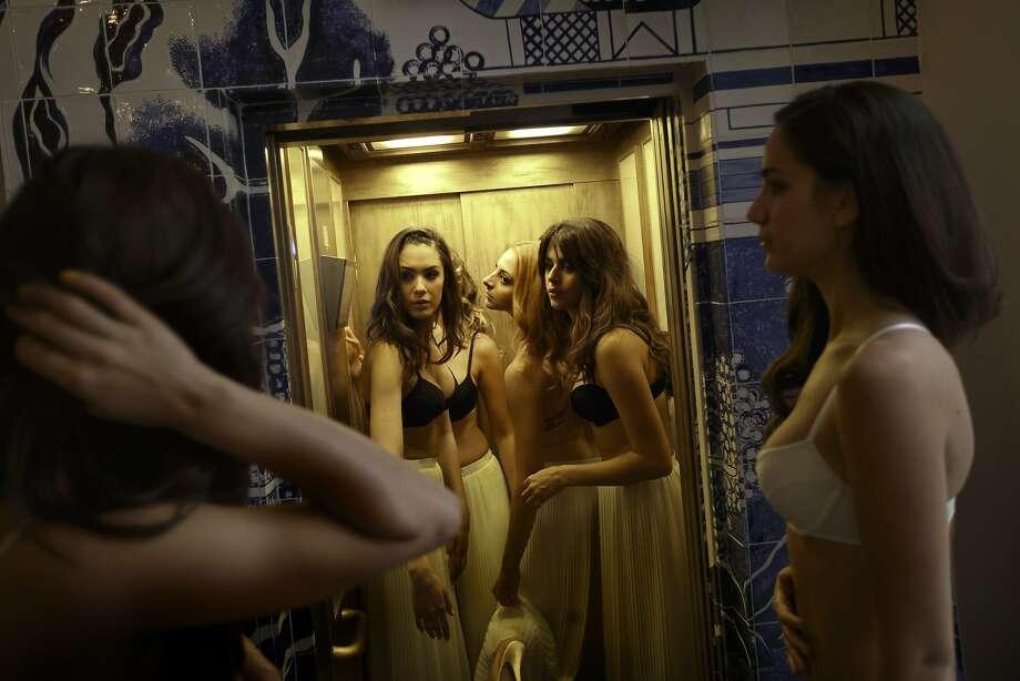 Second floor, ladies' lingerie:Models take a backstage elevator after an underwear fashion show in Madrid, Spain. Photo: Daniel Ochoa De Olza, Associated Press