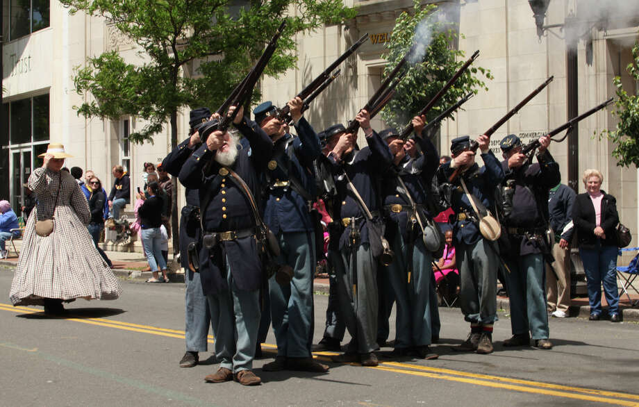 The 11th Regiment Connecticut Volunteer Infantry marches in the Stamford Memorial Day parade on Sunday, May 26, 2013. The parade returns for another year on Sunday, May 25, 2014, beginning at the corner of  corner of Summer and Hoyt streets. Photo: BK Angeletti, B.K. Angeletti / Connecticut Post freelance B.K. Angeletti