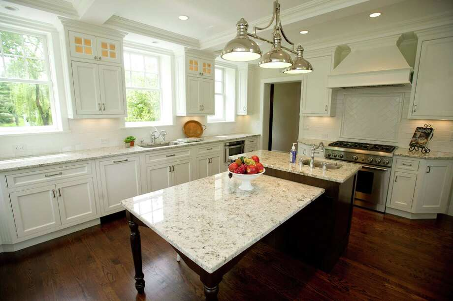 The kitchen in the home at 75 Dearfield Drive in Greenwich, Conn. The home is 90 years old and has undergone a major renovation. Photo: Lindsay Perry / Stamford Advocate