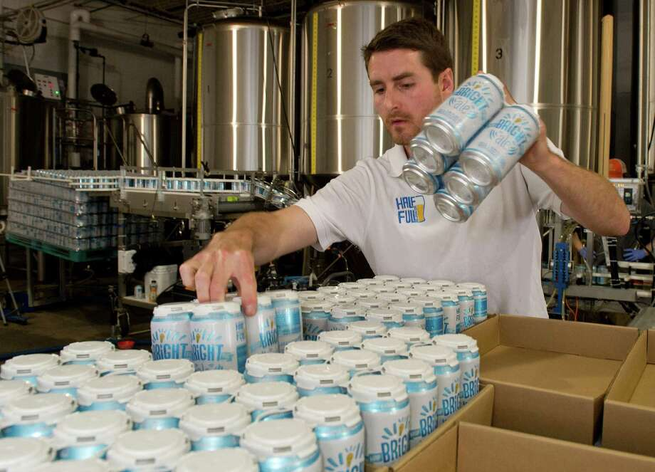 Jordan Giles stacks completed six-packs of Bright Ale on a pallet at Half Full Brewery in Stamford, Conn., on Wednesday, May 21, 2014. Photo: Lindsay Perry / Stamford Advocate