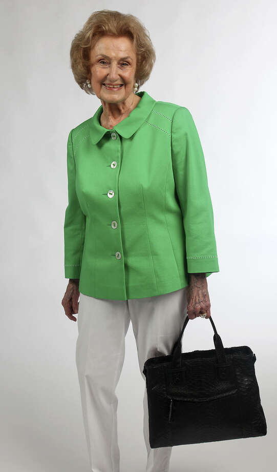 Charline McCombsprefers bags with handles and changes them weekly. / San Antonio Express-News