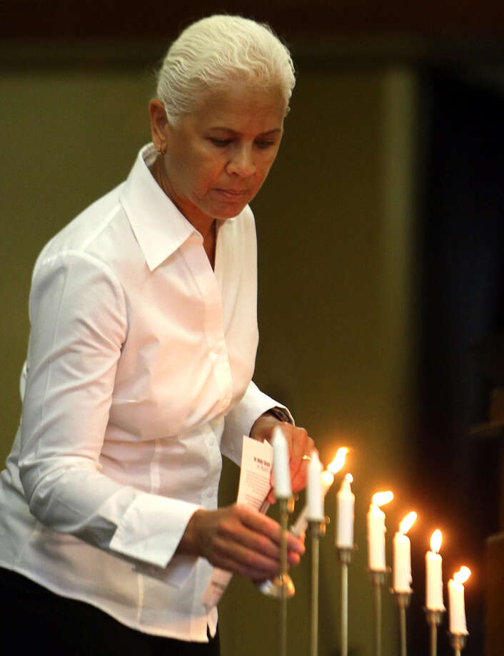 Recall it as it was, a horror: A woman lights a candle during a Holocaust Remembrance ceremony  in Panama City, Fla. Photo: Andrew Wardlow / Associated Press / Panama City News Herald/Panama C