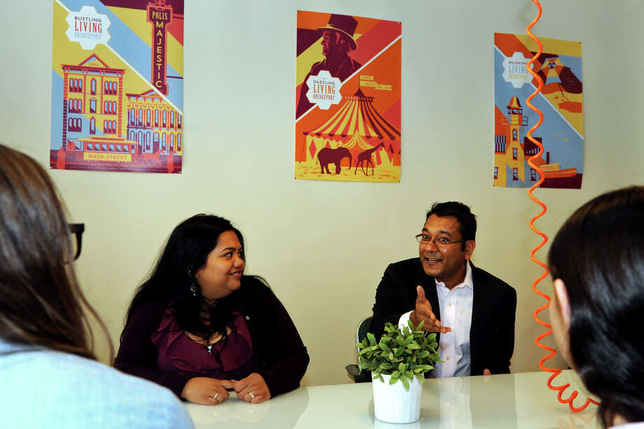 Manish Chowdhary, right, CEO of GoECart, and business manager Indy Pereira introduce themselves during a roundtable discussion for local Bridgeport business leaders and entrepreneurs held at the B:Hive, in Bridgeport, Conn. May 21, 2014. Photo: Ned Gerard / Connecticut Post