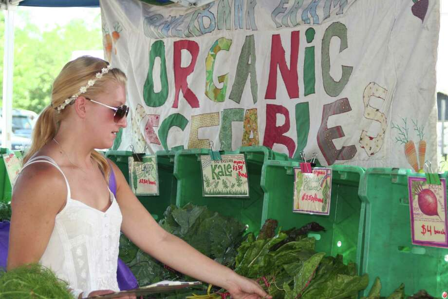 Devan Alusik, one of five shoppers employed by Fresh Nation, selects CT-grown produce at a Fairfield County-area farmers' market. Fresh Nation, founded by Greenwich residents Anthony and Melanie Lee, gathers food from farmers' markets around the county and delivers it, via online orders, to customers. The startup has just announced partnerships with the Westport and Pleasantville farmers' markets. Photo: Contributed Photo / Stamford Advocate Contributed