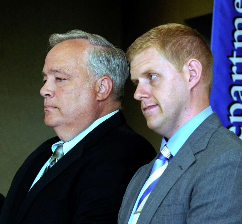 Steve Varga, left, and Jeff Brewster received a Civilian Award Wednesday, May 21, 2014, at the Danbury Police Department's annual memorial service and awards ceremony at police headquarters in Danbury, Conn. Photo: Carol Kaliff / The News-Times