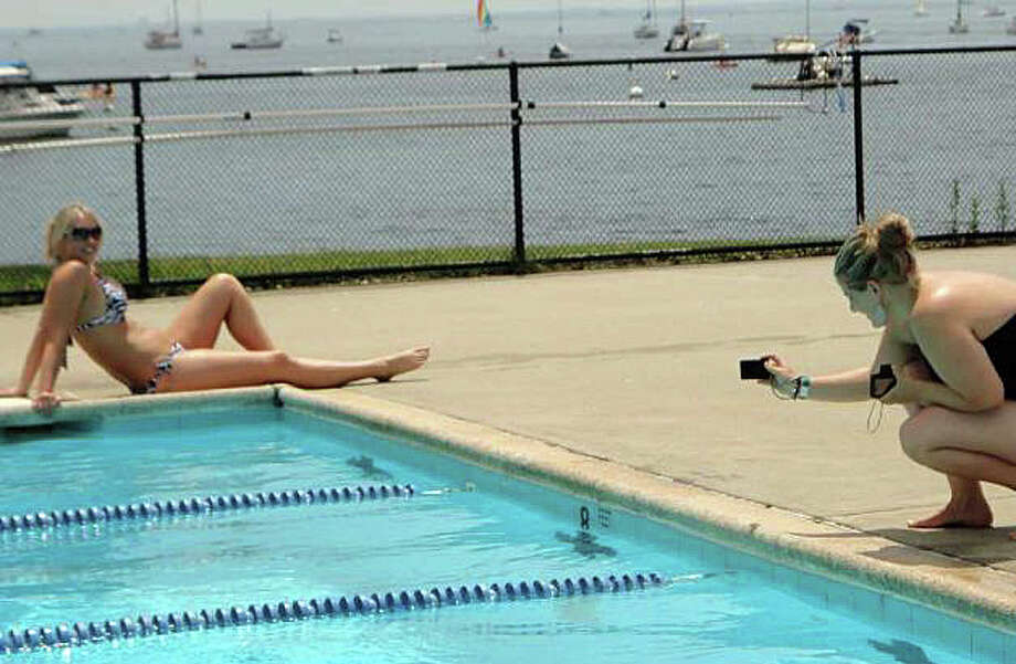 Fun at the Longshore Club Park's swimming pools will have to wait at least a week later than the usual Memorial Day weekend opening because of lingering damage from the harsh winter. Photo: File Photo / Westport News