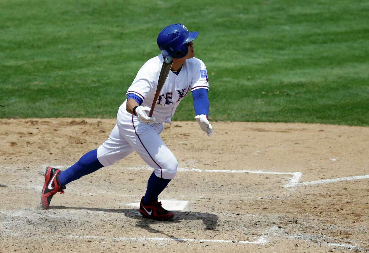 Texas Rangers' Shin-Soo Choo of South Korea watches the flight of his solo home run that came off a pitch from Seattle Mariners' Chris Young in the fifth inning of a baseball game, Wednesday, May 21, 2014, in Arlington, Texas. The Rangers won 4-3. (AP Photo/Tony Gutierrez)