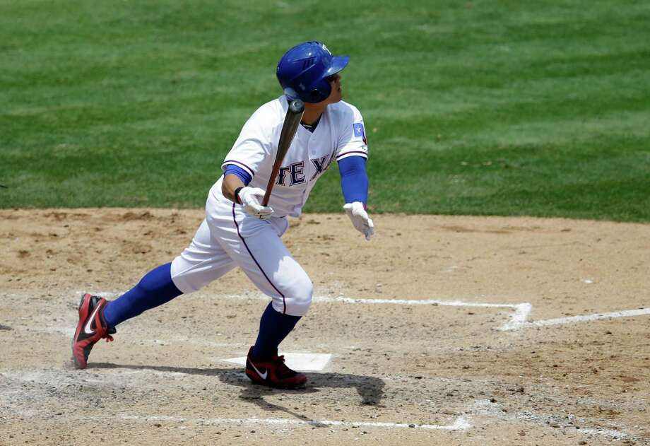 Texas Rangers' Shin-Soo Choo of South Korea watches the flight of his solo home run that came off a pitch from Seattle Mariners' Chris Young in the fifth inning of a baseball game, Wednesday, May 21, 2014, in Arlington, Texas. The Rangers won 4-3. (AP Photo/Tony Gutierrez) Photo: Tony Gutierrez, Associated Press / AP
