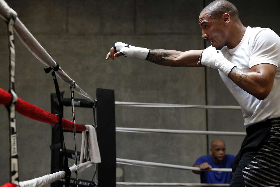 Super middleweight champion Andre Ward works in the ring as his coach and godfather Virgil Hunter watches from the ropes at Ward's private gym in Hayward, CA, Wednesday May 14, 2014. Photo: Michael Short, The Chronicle