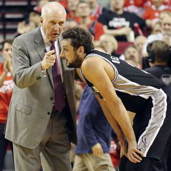 San Antonio Spurs head coach Gregg Popovich talks with San Antonio Spurs' Marco Belinelli during first half action of Game 4 in the Western Conference semifinals against the Portland Trail Blazers Monday May 12, 2014 at the Moda Center in Portland, OR. Photo: Edward A. Ornelas, San Antonio Express-News