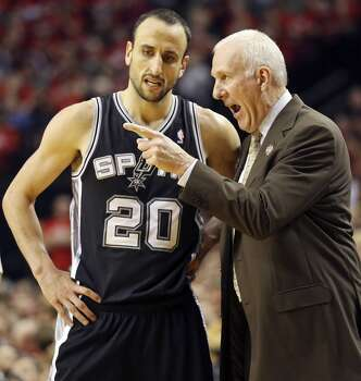 San Antonio Spurs' Manu Ginobili talks with head coach Gregg Popovich during second half action of Game 3 in the Western Conference semifinals Saturday May 10, 2014 at the Moda Center in Portland, OR. Photo: Edward A. Ornelas, San Antonio Express-News